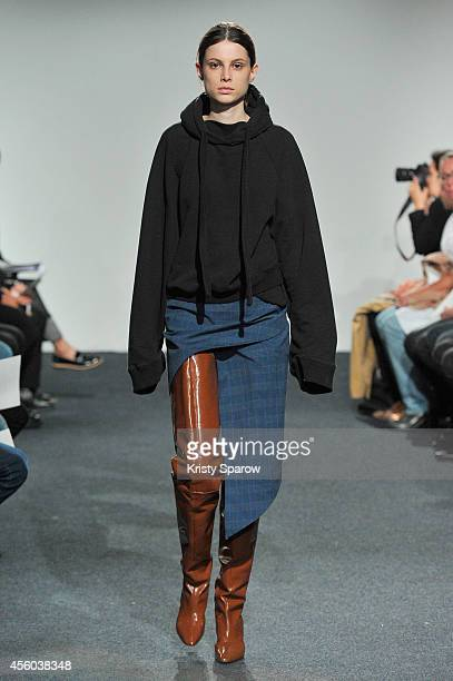 A model walks the runway during the Vetements show as part of Paris Fashion Week Womenswear Spring/Summer 2015 on September 24 2014 in Paris France