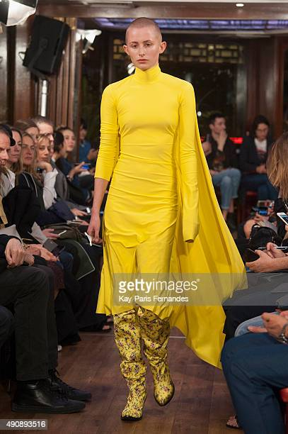 A model walks the runway during the Vetements show as part of the Paris Fashion Week Womenswear Spring/Summer 2016 on October 1 2015 in Paris France
