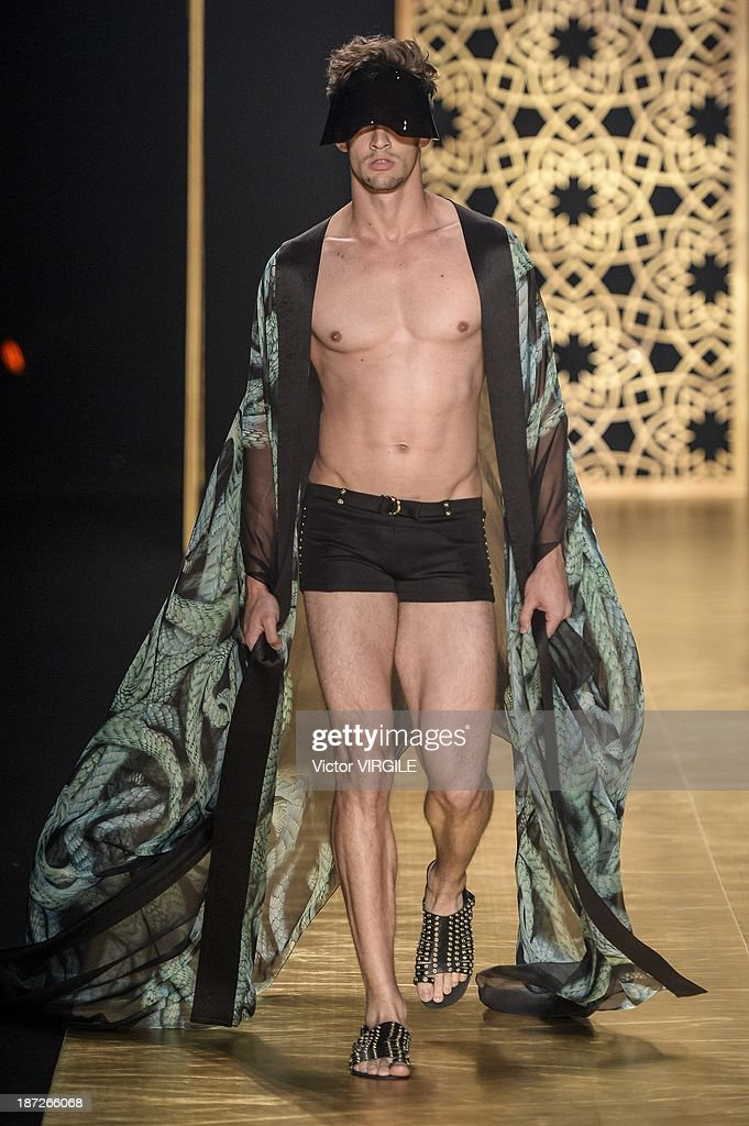 A model walks the runway during the Victor Dzenk show as part of the Rio de Janeiro Fashion Week Fall/Winter 2014 on November 6 2013 in Rio de...