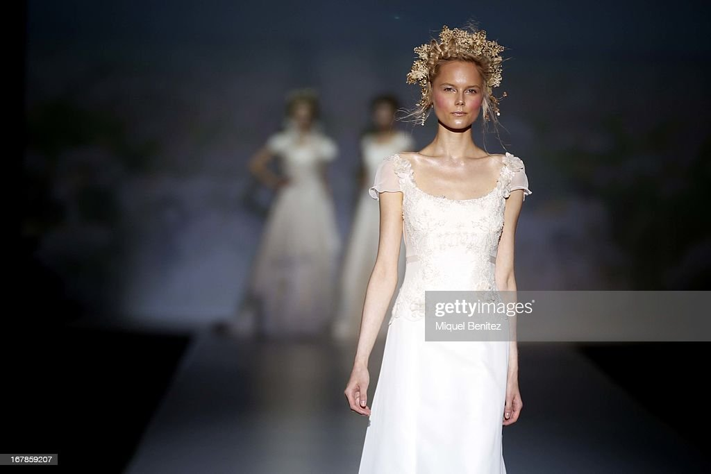 A model walks the runway during the Victorio & Lucchino bridal collection at the Barcelona Bridal Week 2013 on May 1, 2013 in Barcelona, Spain.