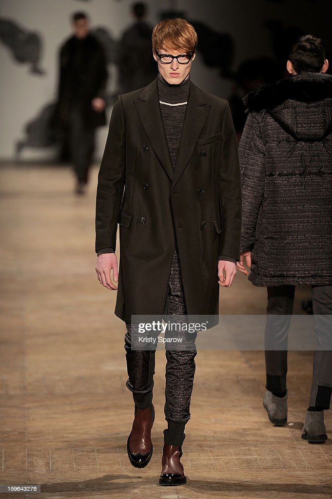 A model walks the runway during the Viktor & Rolf Menswear Autumn / Winter 2013/14 show as part of Paris Fashion Week on January 17, 2013 in Paris, France.