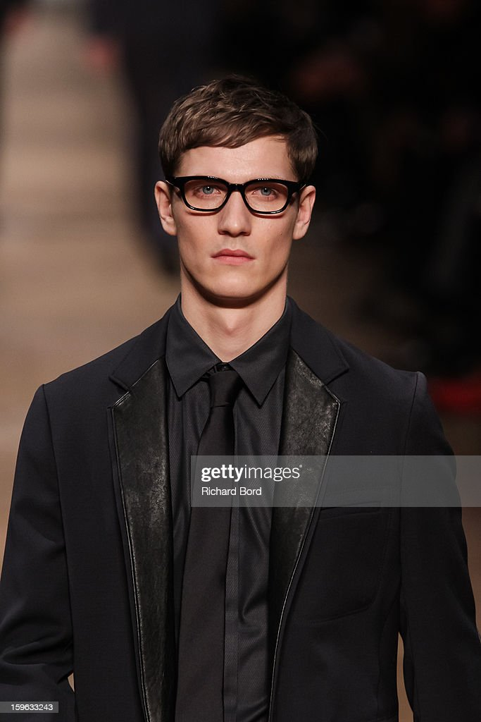A model walks the runway during the Viktor&Rolf Men Autumn / Winter 2013 show as part of Paris Fashion Week on January 17, 2013 in Paris, France.