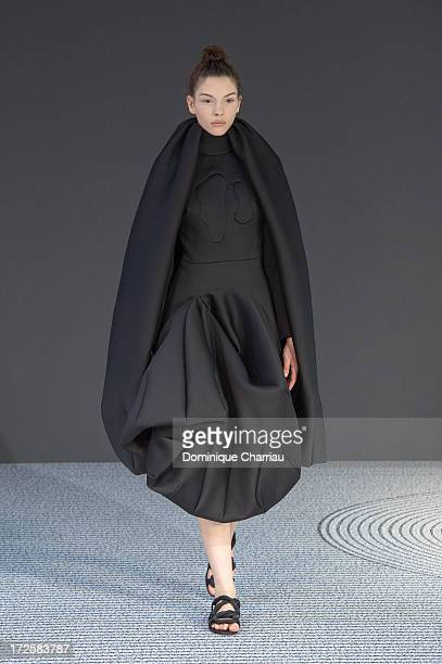 A model walks the runway during the ViktorRolf show as part of Paris Fashion Week HauteCouture Fall/Winter 20132014 at La Gaite Lyrique on July 3...