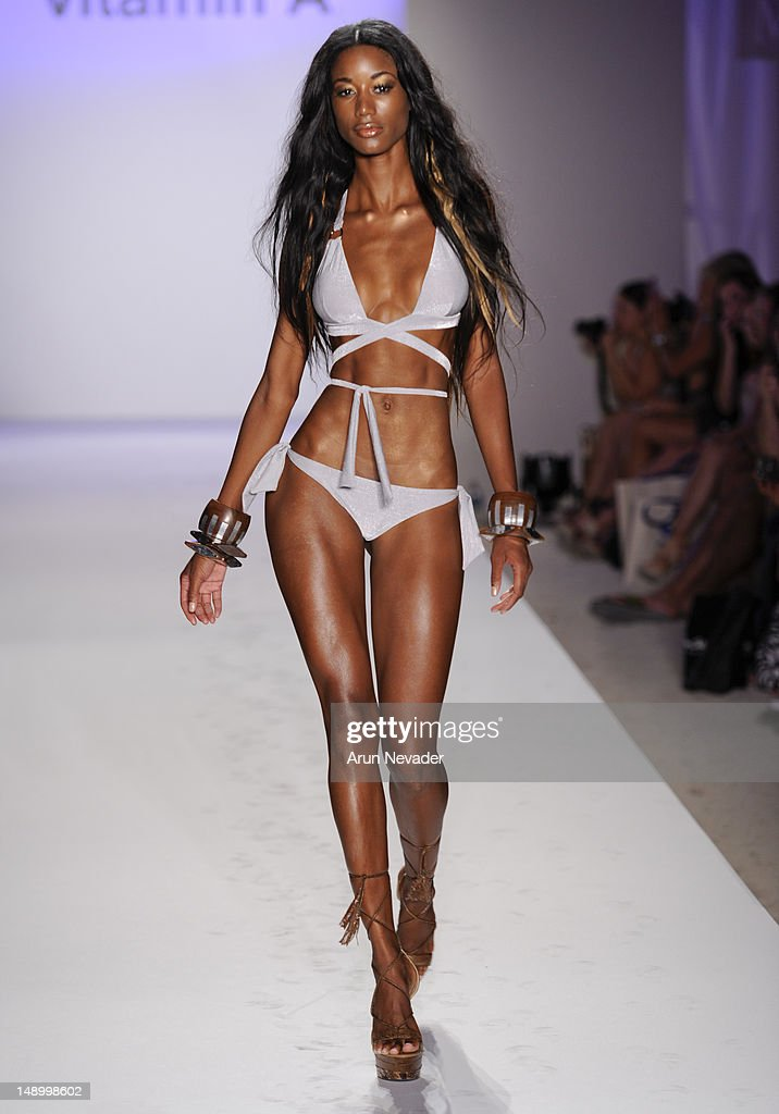 A model walks the runway during the Vitamin A By Amahlia Stevens fashion show at The Raleigh on July 20, 2012 in Miami, Florida.