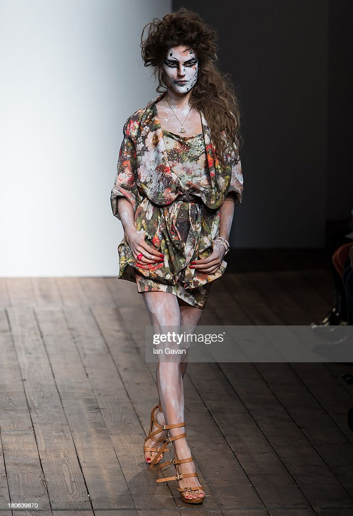 A model walks the runway during the Vivienne Westwood Red Label show during London Fashion Week SS14 at the German Gymnasium on September 15, 2013 in London, England.