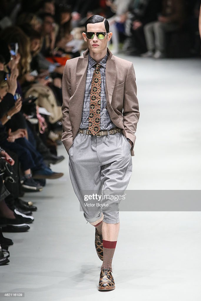 A model walks the runway during the Vivienne Westwood show as a part of Milan Fashion Week Menswear Autumn/Winter 2014 on January 12, 2014 in Milan, Italy.