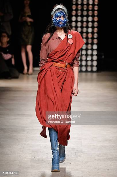 A model walks the runway during the Vivienne Westwood show as part of the Paris Fashion Week Womenswear Fall/Winter 2016/2017 on March 5 2016 in...