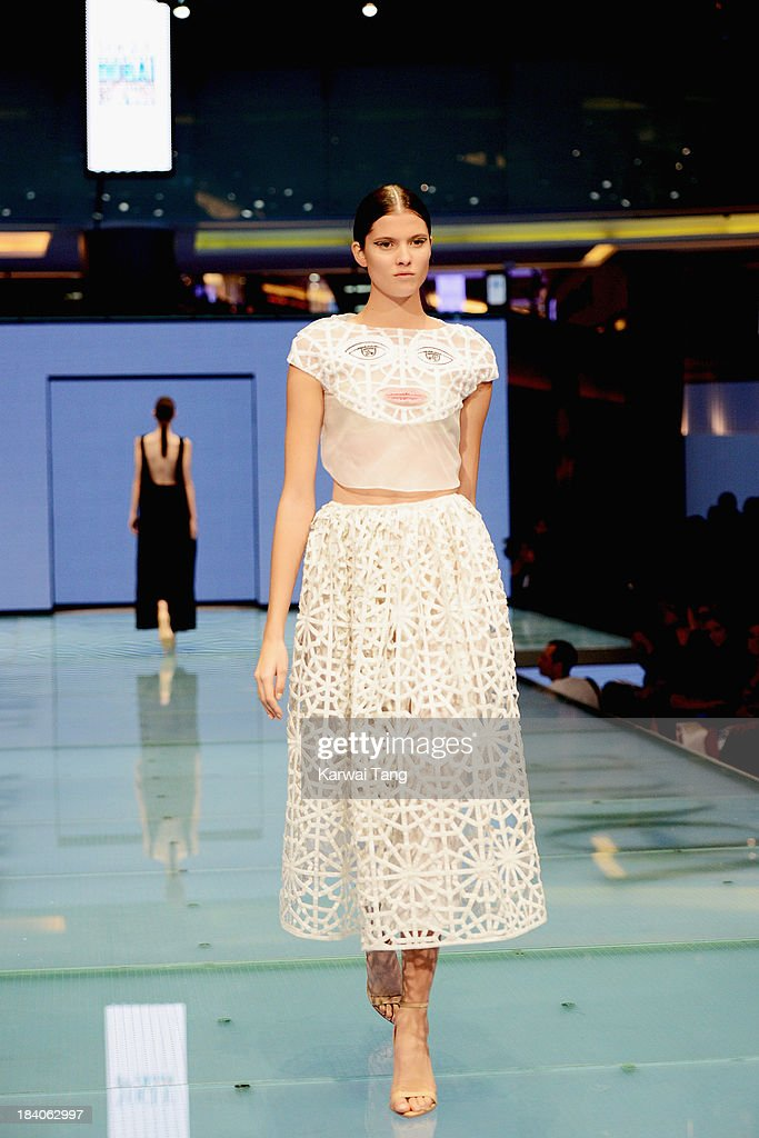 A model walks the runway during the Vogue Fashion Dubai Experience at Dubai Mall on October 10, 2013 in Dubai, United Arab Emirates.