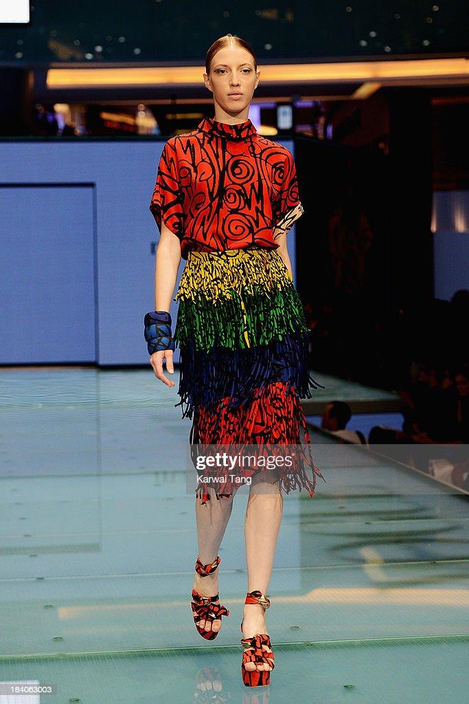 A model walks the runway during the Vogue Fashion Dubai Experience at Dubai Mall on October 10, 2013 in Dubai, United Arab Emirates.