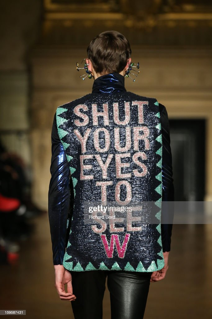 A model walks the runway during the Walter Van Beirendonck Men Autumn / Winter 2013 show as part of Paris Fashion Week on January 16, 2013 in Paris, France.