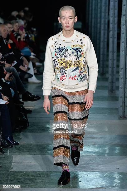 A model walks the runway during the Walter Van Beirendonck Menswear Fall/Winter 20162017 show as part of Paris Fashion Week on January 20 2016 in...