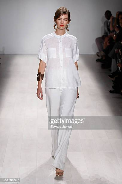 A model walks the runway during the Whitney Linen fashion show at David Pecaut Square on October 24 2013 in Toronto Canada
