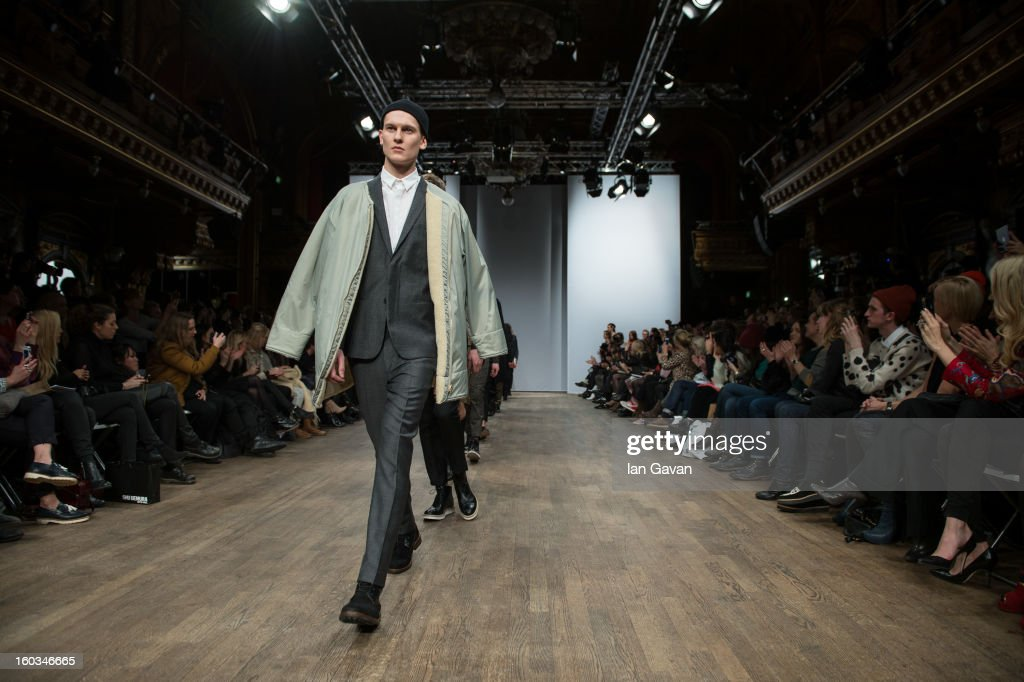 A model walks the runway during the Whyred show at Mercedes-Benz Stockholm Fashion Week Autumn/Winter 2013 at Berns on January 29, 2013 in Stockholm, Sweden.