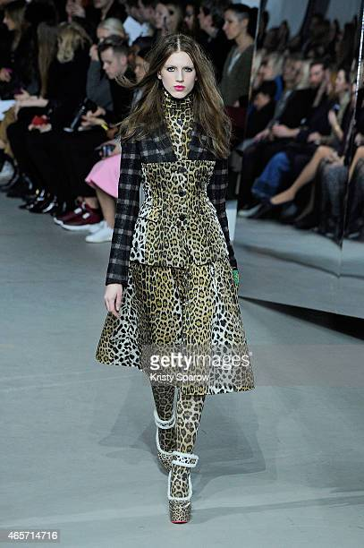 A model walks the runway during the Wunderkind show as part of Paris Fashion Week Womenswear Fall/Winter 2015/2016 at Palais De Tokyo on March 9 2015...