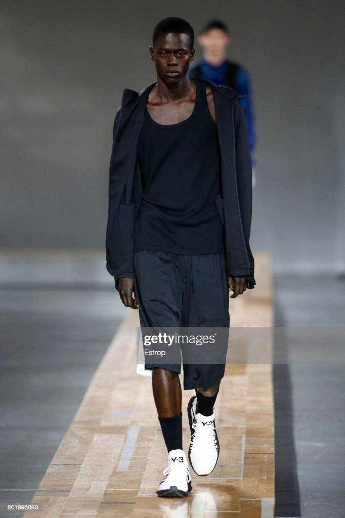 model-walks-the-runway-during-the-y3-menswear-springsummer-2018-show-picture-id801896090