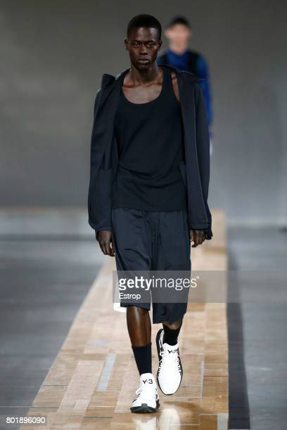 A model walks the runway during the Y3 Menswear Spring/Summer 2018 show as part of Paris Fashion Week on June 25 2017 in Paris France