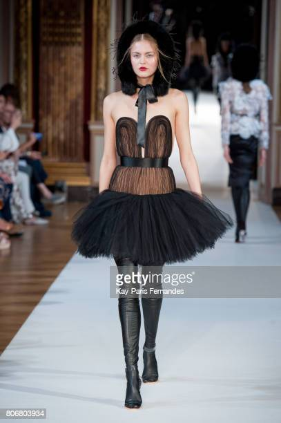 A model walks the runway during the Yanina Couture Haute Couture Fall/Winter 20172018 show as part of Haute Couture Paris Fashion Week on July 3 2017...