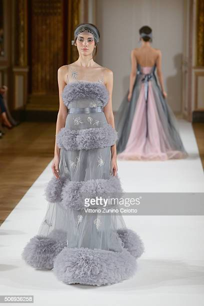 A model walks the runway during the Yanina Couture Spring Summer 2016 show as part of Paris Fashion Week on January 26 2016 in Paris France