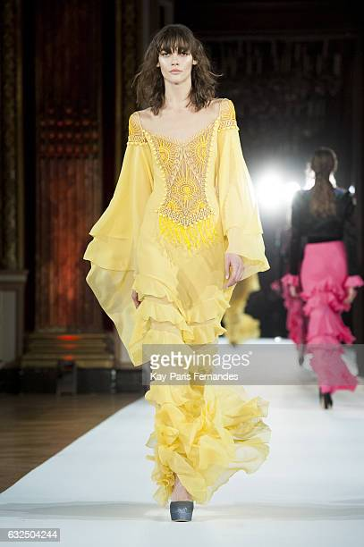 A model walks the runway during the Yanina Couture Spring Summer 2017 show as part of Paris Fashion Week on January 23 2017 in Paris France