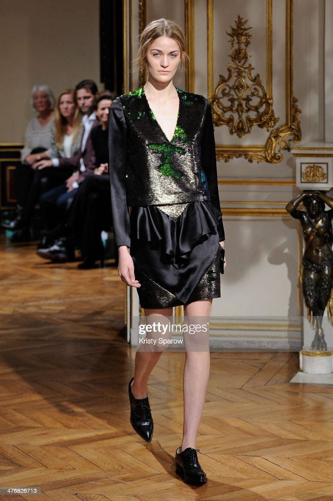 A model walks the runway during the YDE show as part of Paris Fashion Week Womenswear Fall/Winter 2014-2015 on March 5, 2014 in Paris, France.