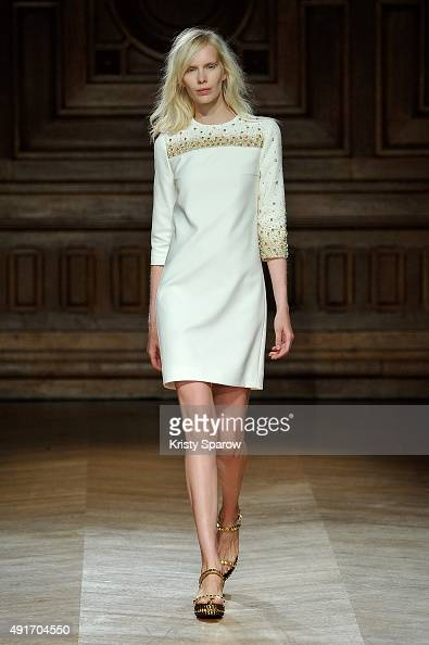 A model walks the runway during the YDE show as part of Paris Fashion Week Womenswear Spring/Summer 2016 on October 7 2015 in Paris France
