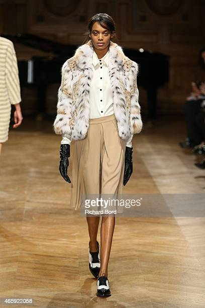 A model walks the runway during the YDE show as part of the Paris Fashion Week Womenswear Fall/Winter 2015/2016 on March 11 2015 in Paris France