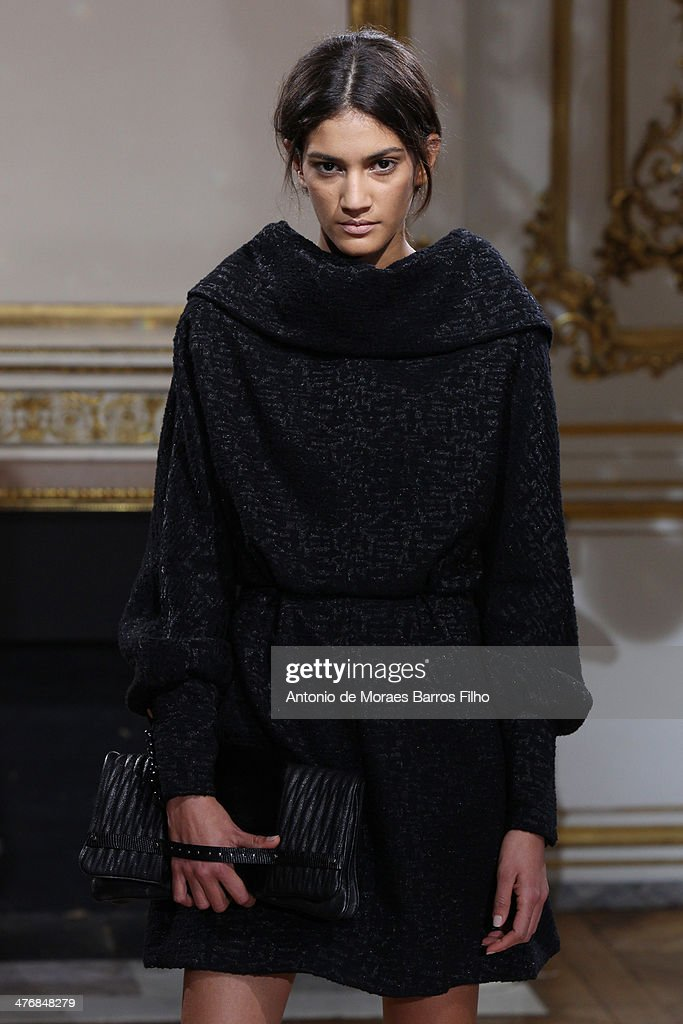A model walks the runway during the YDE show as part of the Paris Fashion Week Womenswear Fall/Winter 2014-2015 on March 5, 2014 in Paris, France.