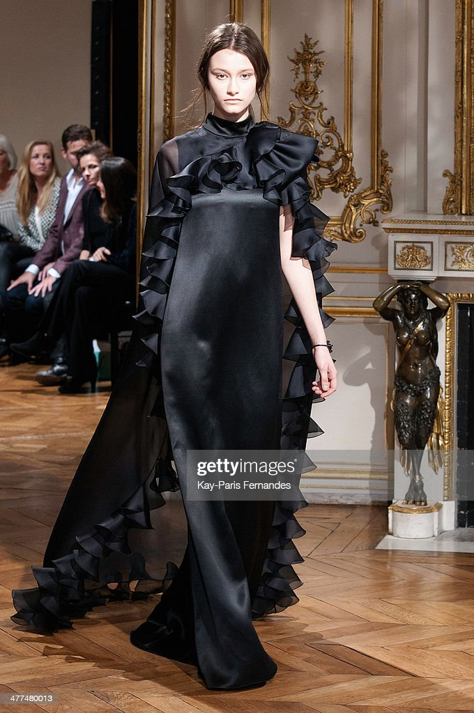 <<A model walks the runway during the YDE show as part of the Paris Fashion Week Womenswear Fall/Winter 2014-2015 on March 5, 2014 in Paris, France.