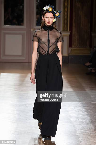 A model walks the runway during the YDE show as part of the Paris Fashion Week Womenswear Spring/Summer 2017 on October 5 2016 in Paris France