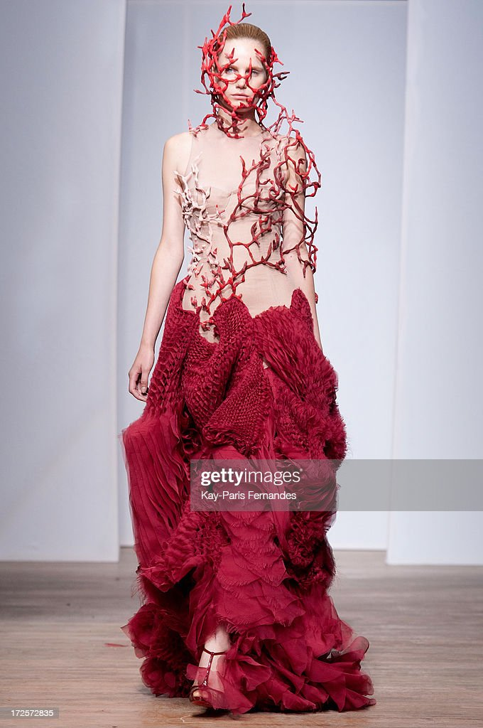 A model walks the runway during the Yiqing Yin show as part of Paris Fashion Week Haute-Couture Fall/Winter 2013-2014 at on July 3, 2013 in Paris, France.