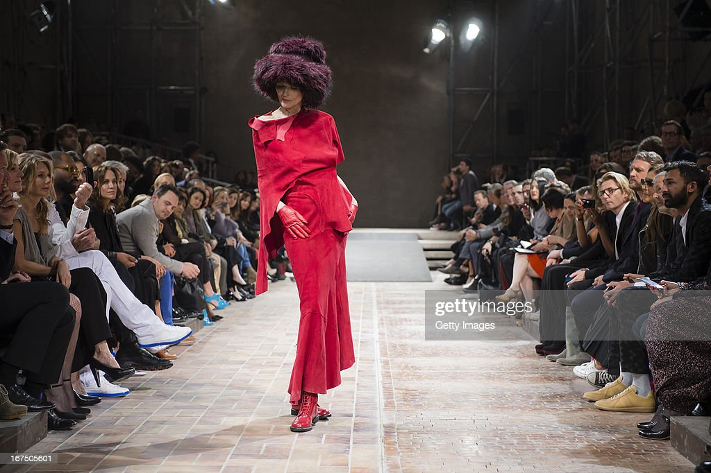 A model walks the runway during the Yohji Yamamoto fashion show 'Cutting Age' at St. Agnes Church on April 25, 2013 in Berlin, Germany.