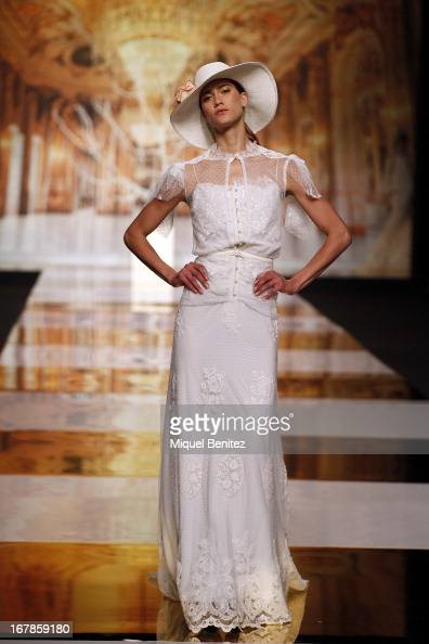 A model walks the runway during the Yolan Cris bridal collection at the Barcelona Bridal Week 2013 on May 1 2013 in Barcelona Spain