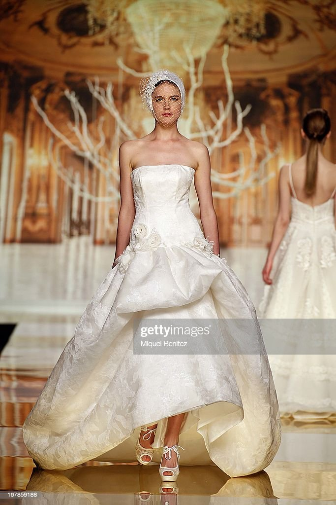 A model walks the runway during the Yolan Cris bridal collection at the Barcelona Bridal Week 2013 on May 1, 2013 in Barcelona, Spain.