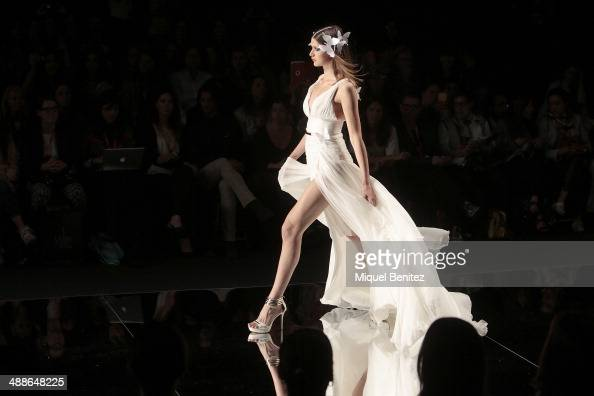 A model walks the runway during the YolanCris fashion show as part of 'Barcelona Bridal Week 2014' on May 7 2014 in Barcelona Spain