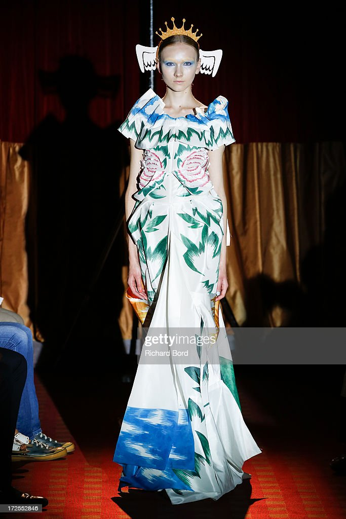A model walks the runway during the Yoshiki Hishinuma Couture show as part of Paris Fashion Week Haute-Couture Fall/Winter 2013-2014 at Hotel Lutetia on July 3, 2013 in Paris, France.