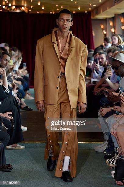 A model walks the runway during the Y/Project Menswear Spring/Summer 2017 show as part of Paris Fashion Week at Maxim's sur Seine on June 22 2016 in...