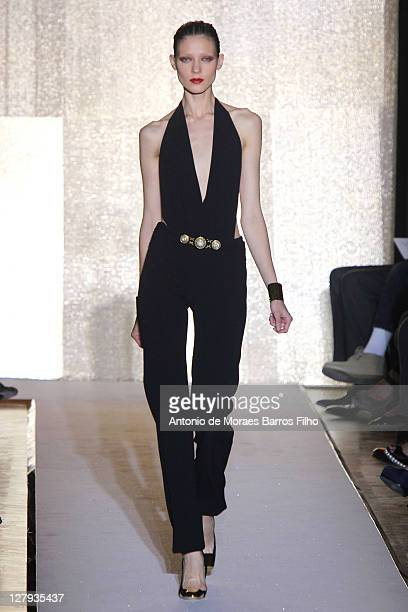 A model walks the runway during the Yves Saint Laurent Ready to Wear Spring / Summer 2012 show during Paris Fashion Week on October 3 2011 in Paris...