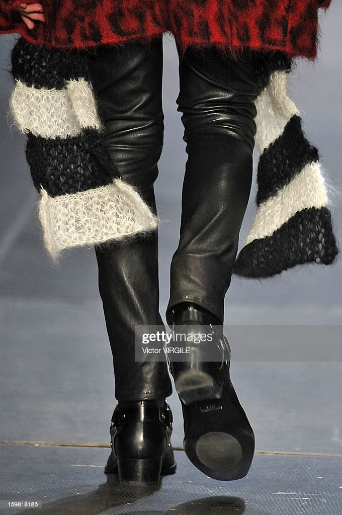 A model walks the runway during the Yves Saint Laurent Ready to Wear Fall/Winter 2013-2014 show as part of Paris Fashion Week at on January 20, 2013 in Paris, France.