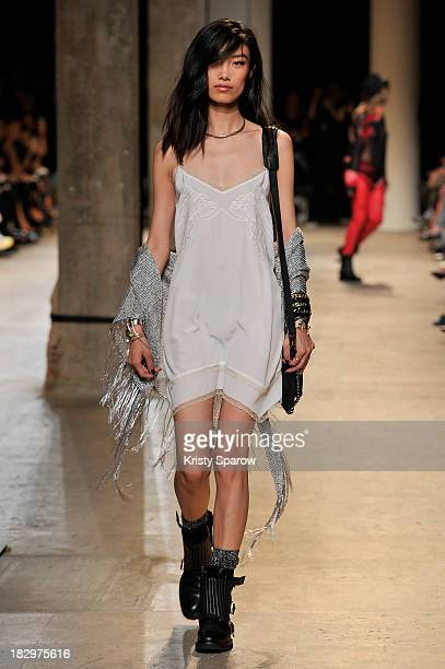 A model walks the runway during the Zadig Voltaire show as part of Paris Fashion Week Womenswear Spring/Summer 2014 on October 2 2013 in Paris France