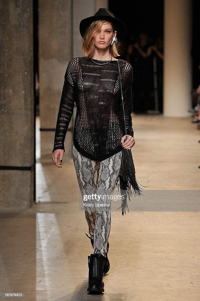 A model walks the runway during the Zadig & Voltaire show as part of Paris Fashion Week Womenswear Spring/Summer 2014 on October 2, 2013 in Paris, France.