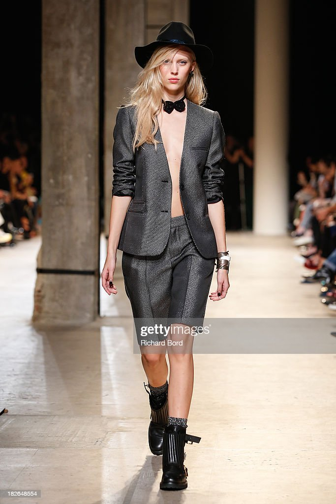 A model walks the runway during the Zadig & Voltaire show at 'Palais de Tokyo' as part of the Paris Fashion Week Womenswear Spring/Summer 2014 on October 2, 2013 in Paris, France.
