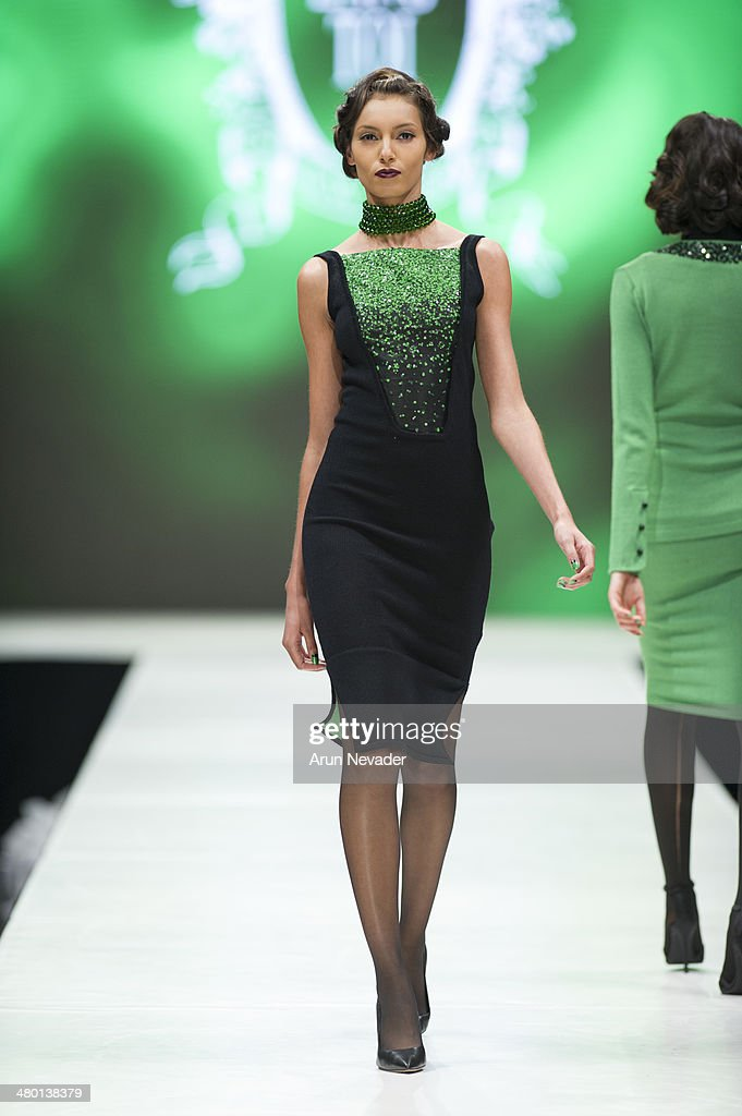 A model walks the runway during the Zang Toi fashion show at El Paseo Fashion Week 2014 on March 22, 2014 in Palm Desert, California.