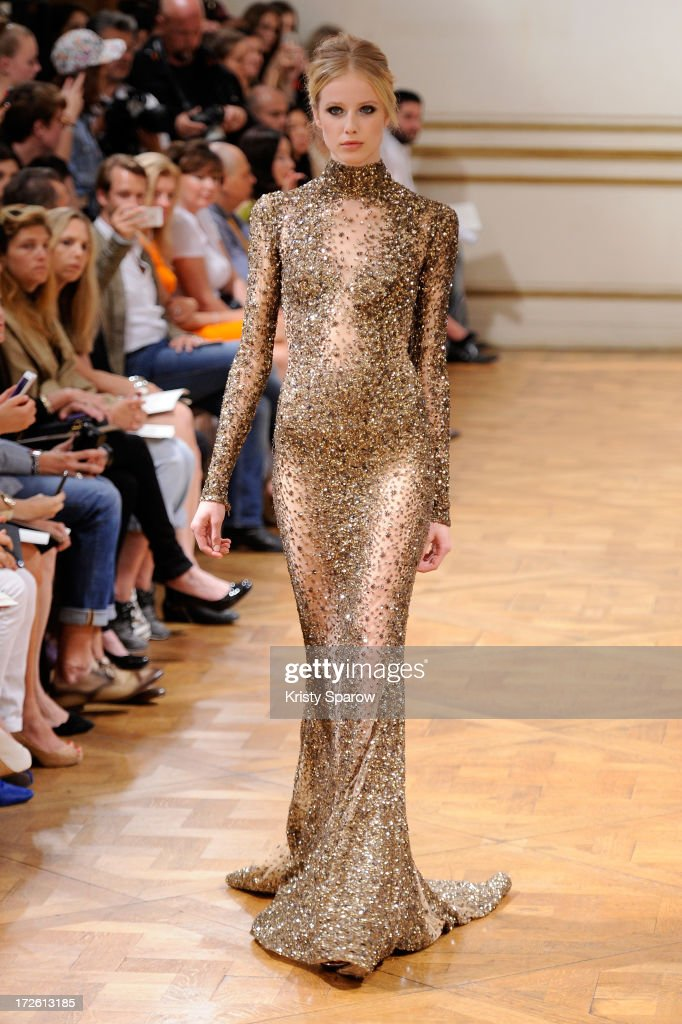 A model walks the runway during the Zuhair Murad show as part of Paris Fashion Week Haute-Couture Fall/Winter 2013-2014 at Hotel de Montmorency on July 4, 2013 in Paris, France.
