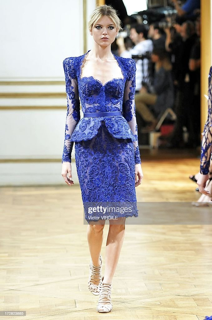 A model walks the runway during the Zuhair Murad show as part of Paris Fashion Week Haute-Couture Fall/Winter 2013-2014 at the Hotel de Montmorency on July 4, 2013 in Paris, France.