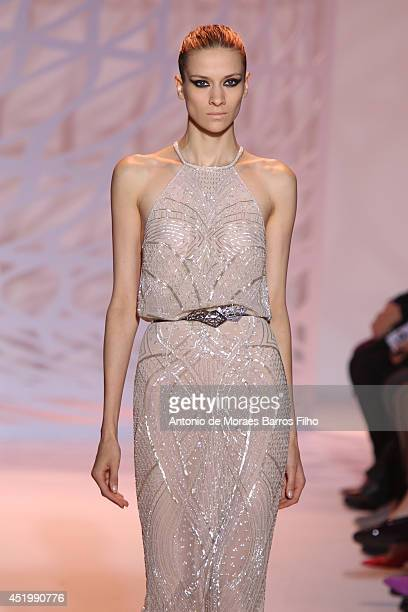 A model walks the runway during the Zuhair Murad show as part of Paris Fashion Week Haute Couture Fall/Winter 20142015 at Mairie du 4e on July 10...