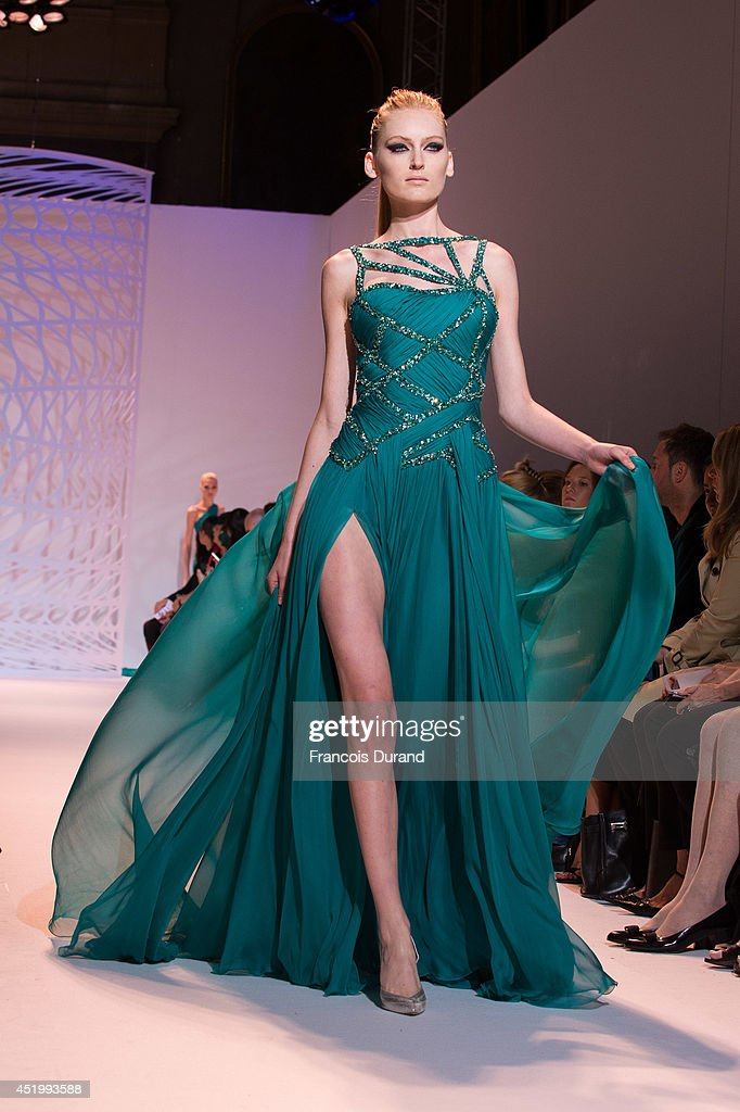 A model walks the runway during the Zuhair Murad show as part of Paris Fashion Week - Haute Couture Fall/Winter 2014-2015 at Palais Des Beaux Arts on July 10, 2014 in Paris, France.