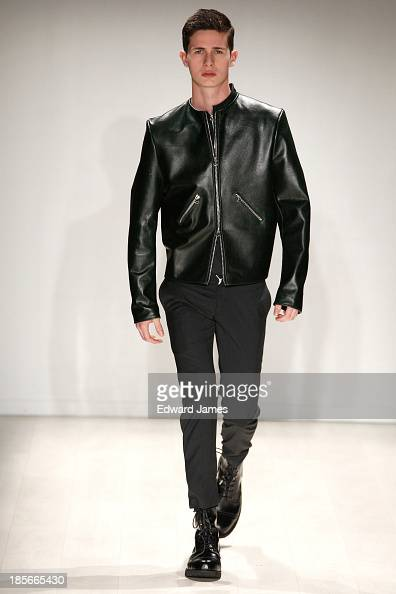 A model walks the runway during theAxel K fashion show at David Pecaut Square on October 23 2013 in Toronto Canada