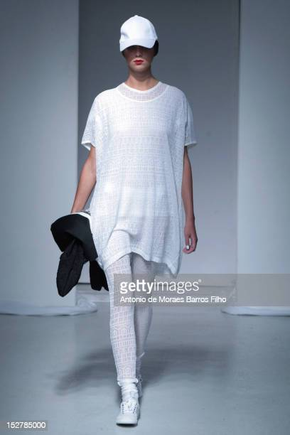 A model walks the runway during theDevastee Spring / Summer 2013 show as part of Paris Fashion Week at Espace Commines on September 26 2012 in Paris...