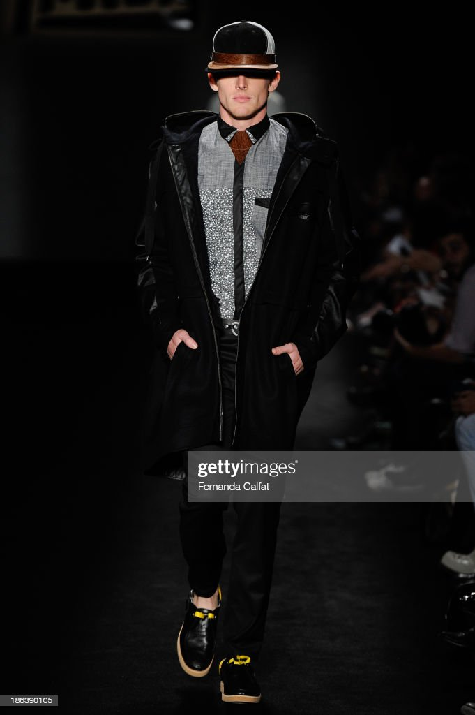 A model walks the runway during Triton show at Sao Paulo Fashion Week Winter 2014 on October 30, 2013 in Sao Paulo, Brazil.