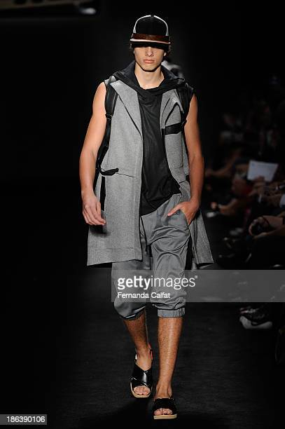 A model walks the runway during Triton show at Sao Paulo Fashion Week Winter 2014 on October 30 2013 in Sao Paulo Brazil